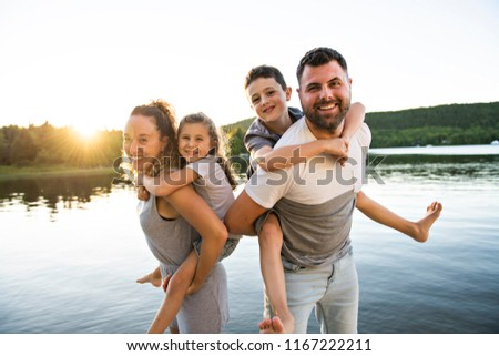 family on the pier warm summer day having good time with bengal fires stock photo © lopolo