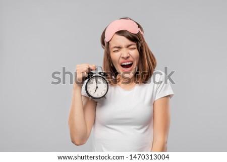 Jeune femme réveil danger Photo stock © pressmaster