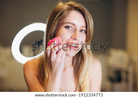 Close-up of a face of a young girl who smiles and a shadow from a metal lattice on her face Stock photo © ruslanshramko