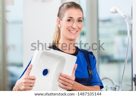 Female worker at work in a sanitary shop with high-quality ceramic fixtures Stock photo © Kzenon