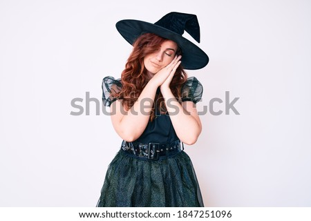 women wearing witch costumes while posing together at halloween stock photo © kzenon
