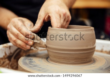 Close up detail view at an artist makes clay pottery on a spin w Stock photo © boggy