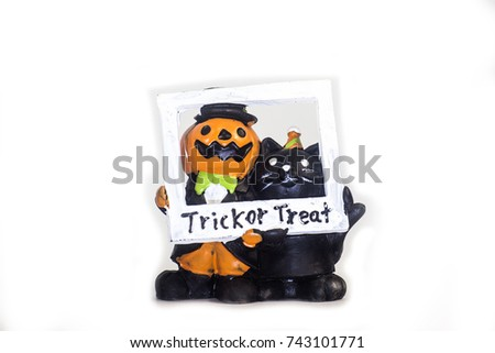 Cat holding pumpkin basket with ghosts in front of tombstones an Stock photo © amaomam