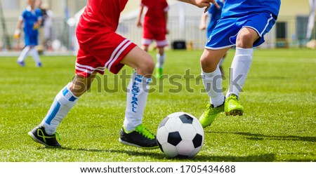 Football Game. Junior Level Boys Kicking Soccer Match on Grass Stock photo © matimix