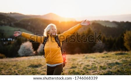 Elöl kilátás aktív idős nő áll Stock fotó © wavebreak_media