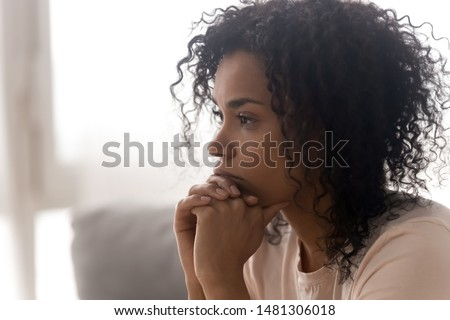 side view of african american beautiful thoughtful woman having coffee in kitchen at home stock photo © wavebreak_media