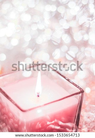 Rose aromatic candle on Christmas and New Years glitter backgrou Stock photo © Anneleven