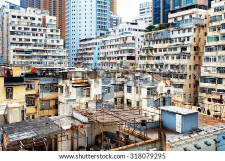 Old houses surrounded modern skyscrapers in Hong Kong. Hong Kong is popular tourist destination of A Stock photo © galitskaya