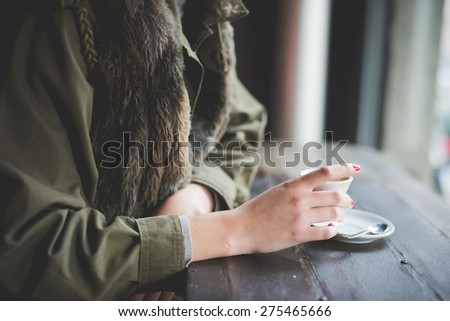 Close-up of a woman with short hair and a Cup of coffee in her hands Stock photo © ElenaBatkova