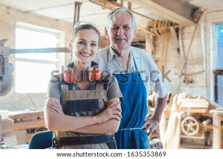 Senior master carpenter with his granddaughter in the wood workshop Stock photo © Kzenon