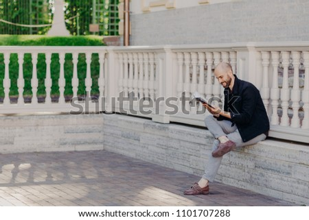 People, positive emotions and hobby concept. Unshaven bald middle aged man with happy expression, fo Stock photo © vkstudio