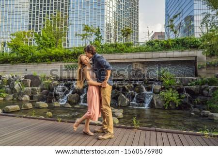 Young couple in love spends their honeymoon in Seoul. Cheonggyecheon stream in Seoul, Korea. Cheongg Stock photo © galitskaya