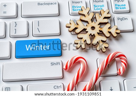 christmas candy on a keyboard concepts of holiday online shopping stock photo © johnkwan