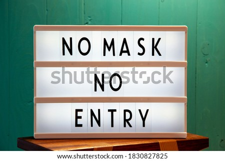 Covid-19 mask obligatory to enter stores . SIGN NO MASK NO ENTRY at storefront window. Face covering Stock photo © Maridav