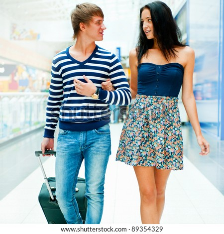 Portrait of young couple walking together at airport hall with t Stock photo © HASLOO