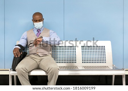 a business man is protecting his face with a briefcase, he looks amused Stock photo © photography33