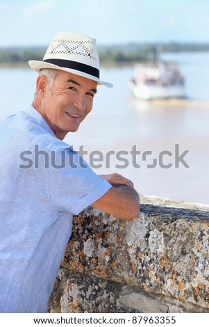 Smiling senior man watching the ferry from Blaye citadel, France Stock photo © photography33