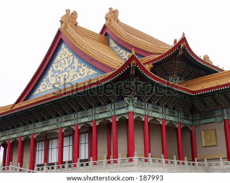 Red roofed hall with ornaments and a tall golden Buddha statue. Stock photo © 3523studio