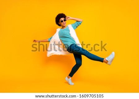 Stylish Trendy Young Woman in Fur Waistcoat and Leggings Posing in Studio Stock photo © gromovataya
