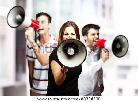 Profile of a businessman shouting with megaphone against white background Stock photo © wavebreak_media
