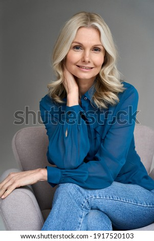 Enjoyment. Classy Elegant Woman Blonde relaxing in Chair. Black Dress and Mask with Feathers Stock photo © gromovataya