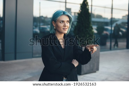 Woman concentrated pointing on something while wearing protective goggles Stock photo © wavebreak_media