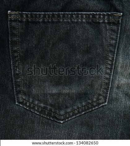 High resolution scan of black denim fabric. The back pocket of a pair of jeans.