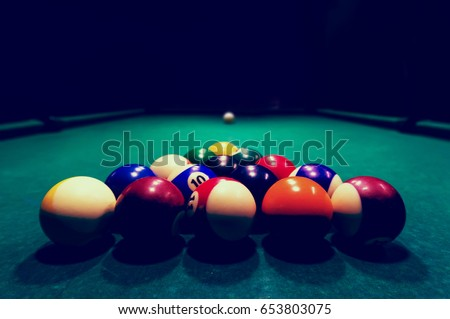 Billards pool game. Color balls in triangle, aiming at cue ball Stock photo © photocreo