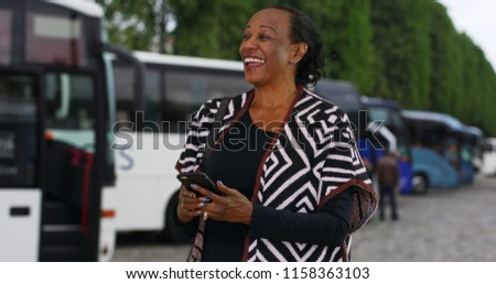 Woman using her smartphone and lots of people portraits around h Stock photo © HASLOO