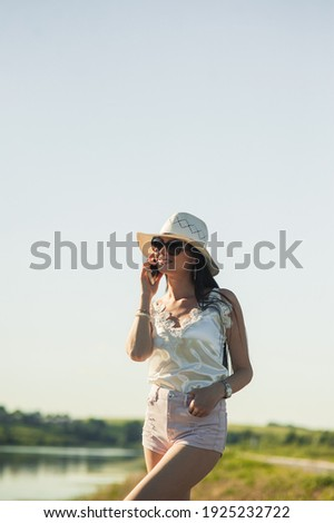 Szexi nő beszél telefon fekete ruha nő mosoly Stock fotó © feelphotoart