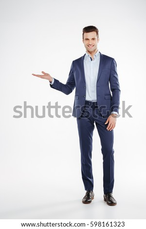 Full length portrait of a smiling man holding invisible product Stock photo © deandrobot