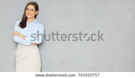 Young beautiful businesswoman standing against white wall with a lot of copyspace Stock photo © deandrobot