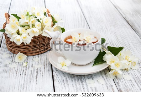 glass cup of green tea with jasmine flowers isolated on white stock photo © tetkoren