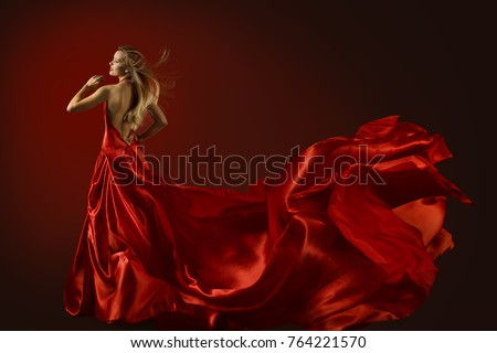 Fashion elegant blond woman model in red gown with blowing fabri Stock photo © Victoria_Andreas