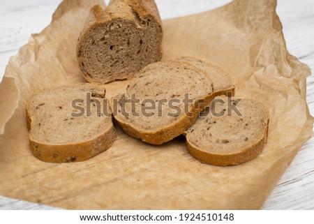 Loaf of homemade bread with black mustard seeds on table with rye spikelets  and oats Stock photo © mcherevan