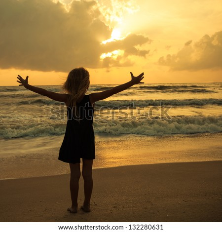 Happy family with little girl standing on beach in evening, look stock photo © Paha_L