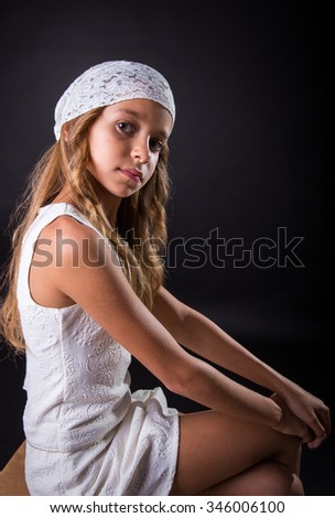 Young Girl With White Cap And Sober Look Sitting On Black Background Zdjęcia stock © BigKnell