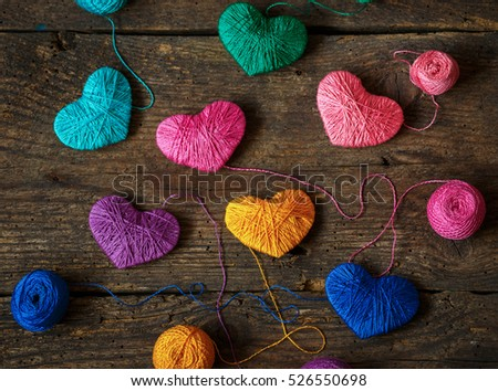purple heart with a ball of thread on on old shabby wooden backg stock photo © vlad_star