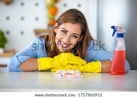 Young woman washing dishes in her modern kitchen, using a dishwa Stock photo © lightpoet