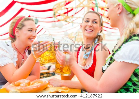 Three Bavarians in traditional costumes sitting in a beer garden Stock photo © kb-photodesign