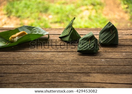 Dessert from banana leave thai style Kaow-neaw-sang-kha-ya on old wooden background outdoor4 Stock photo © Bigbubblebee99