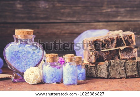 spa setting with towels aroma oil bottle and hand made orchid fl stock photo © dashapetrenko