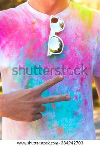 A young man shows the symbol of peace and friendship . Holi fest foto stock © Yatsenko