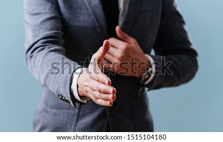A businessman is extending his hand Stock photo © ylivdesign