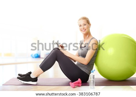 woman stretching hands while sitting on couch with tablet computer stock photo © deandrobot