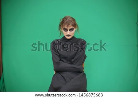pretty brunette woman with make up like demon at halloween clos stock photo © iordani