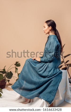 Side view of young woman with long hair sitting on cube eyes closed Stock photo © julenochek