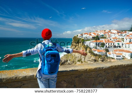 Woman with a backpack behind her back is spinning her arms out t Stock photo © vlad_star