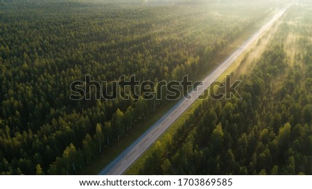 Empty road through countryside in sunset, aerial view drone pov Stock photo © stevanovicigor
