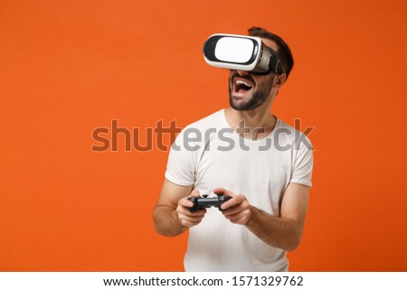 man playing virtual reality VR glasses. Isolated on white backgr Stock photo © studiostoks